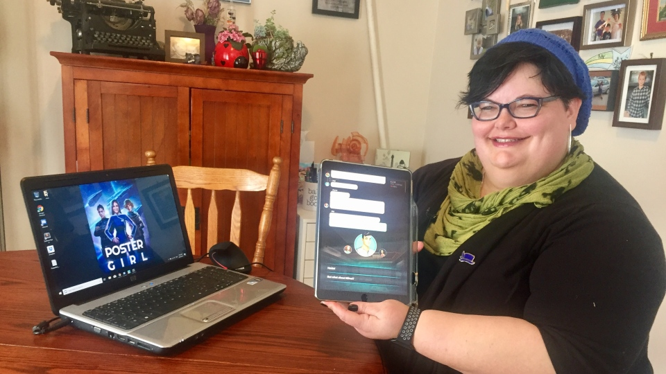 Tonia Laird holds an iPad featuring her new digital novel, Poster Girl. (Courtesy: Laura Woodward/CTV Saskatoon)