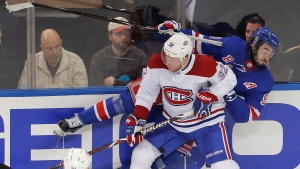 Montreal Canadiens defenseman Christian Folin (32) collides with New York Rangers center Mika Zibanejad (93) during the third period of an NHL hockey game, Friday, March 1, 2019, in New York. The Canadiens won 4-2. (AP Photo/Julie Jacobson)