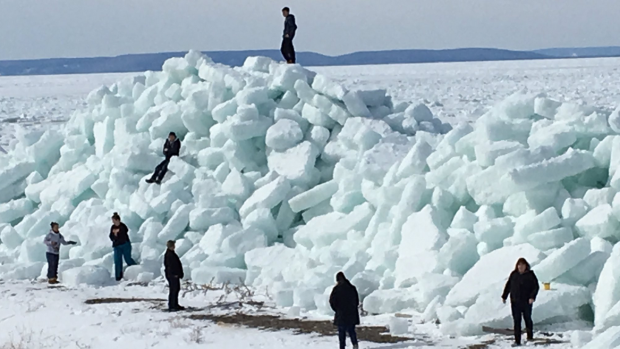 spectators flock to see massive ice wall in n s