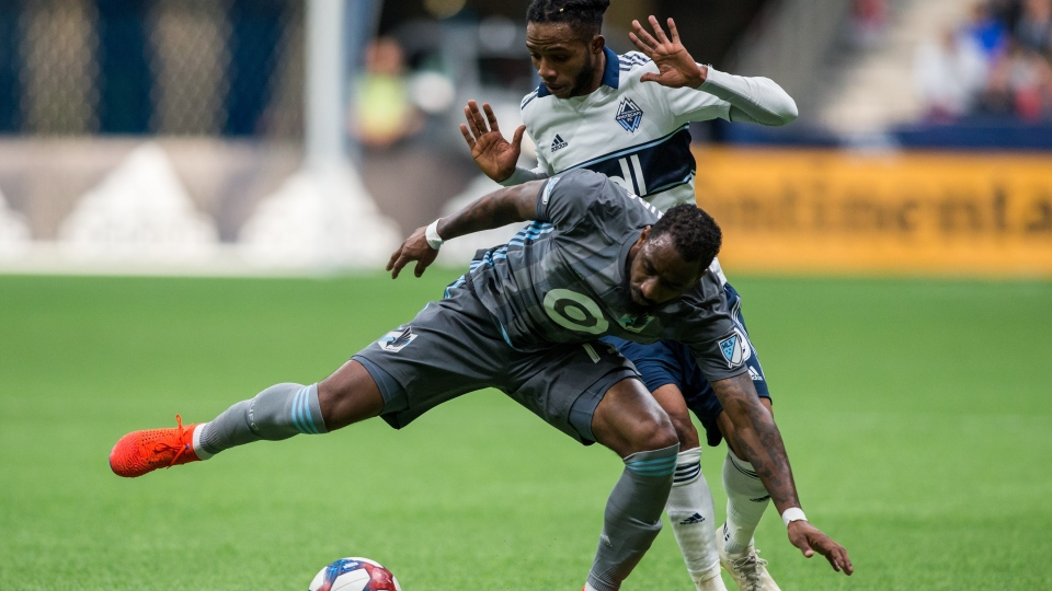 Vancouver Whitecaps' Alhassane Bangoura (19) plays the ball against Minnesota United's Romain Metanire (19) during second half MLS soccer action in Vancouver on Saturday, March 2, 2019. THE CANADIAN PRESS/Ben Nelms