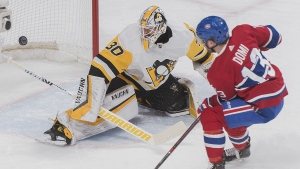 Pittsburgh Penguins goaltender Matt Murray makes a save against Montreal Canadiens' Max Domi during first period NHL hockey action in Montreal, Saturday, March 2, 2019. THE CANADIAN PRESS/Graham Hughes
