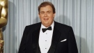 John Candy appears at the Academy Awards in April, 1988. THE CANADIAN PRESS/AP