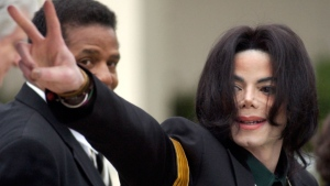 FILE - In this March 2, 2005 file photo, pop icon Michael Jackson waves to his supporters as he arrives for his child molestation trial at the Santa Barbara County Superior Court in Santa Maria, Calif. (AP Photo/Michael A. Mariant, File)