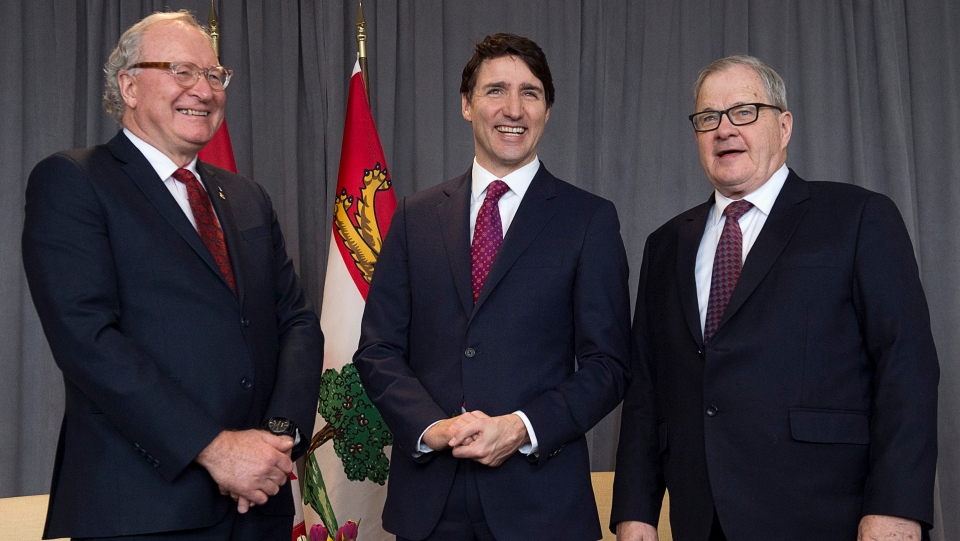 Prime Minister Justin Trudeau is flanked by Prince Edward Island Premier Wade MacLauchlan, left, and Veterans Affairs Minister Lawrence MacAulay, right, as they meet in Charlottetown on Monday, March 4, 2019. (THE CANADIAN PRESS/Andrew Vaughan)