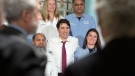 Prime Minister Justin Trudeau poses with workers as he visits the biotechnology company BioVectra Inc. in Charlottetown on Monday, March 4, 2019. THE CANADIAN PRESS/Andrew Vaughan