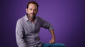 "Luke Perry, a cast member in the CW series ""Riverdale,"" poses for a portrait during the 2018 Television Critics Association Summer Press Tour, Monday, Aug. 6, 2018, in Beverly Hills, Calif. (Photo by Chris Pizzello/Invision/AP)"