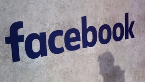 This Jan. 17, 2017, file photo shows a Facebook logo displayed at a business gathering in Paris. The U.S. Justice Department has announced a major antitrust investigation into unnamed tech giants, while the House Judiciary Committee has begun an unprecedented antitrust probe into Google, Facebook, Amazon and Apple over their aggressive business practices.  (AP Photo/Thibault Camus, File)