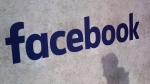 This Jan. 17, 2017, file photo shows a Facebook logo displayed at a business gathering in Paris. (AP Photo/Thibault Camus, File)