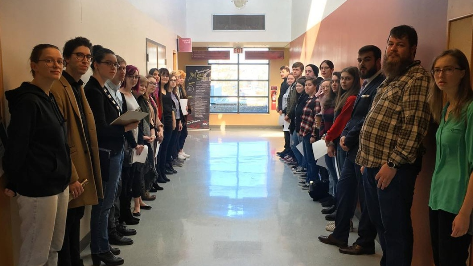 Students from Kwantlen Polytechnic University's music program stand outside a meeting concerning the program's student intake for 2019-20. (CTV News)
