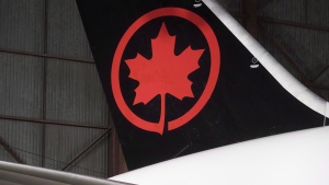 The tail of the newly revealed Air Canada Boeing 787-8 Dreamliner aircraft is seen at a hangar at the Toronto Pearson International Airport in Mississauga, Ont., Thursday, February 9, 2017. (THE CANADIAN PRESS/Mark Blinch)