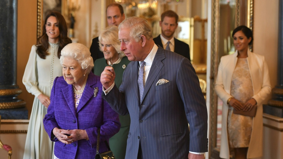 Queen Elizabeth II is joined by Prince Charles, the Prince of Wales, and at rear, from left, Kate, Duchess of Cambridge, Camilla, Duchess of Cornwall, Prince William, Prince Harry and Meghan, Duchess of Sussex during a reception at Buckingham Palace, on March 5, 2019. (Dominic Lipinski / Pool via AP)