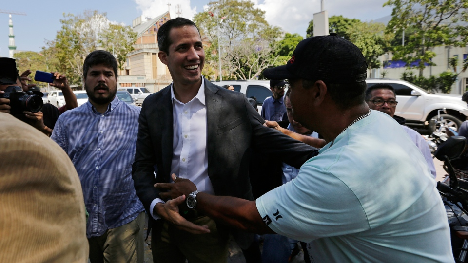 Venezuelan Congress President Juan Guaido, an opposition leader who has declared himself interim president, greets a supporter as he arrives to meet with public employee unions in Caracas, Venezuela, Tuesday, March 5, 2019. (AP / Fernando Llano)