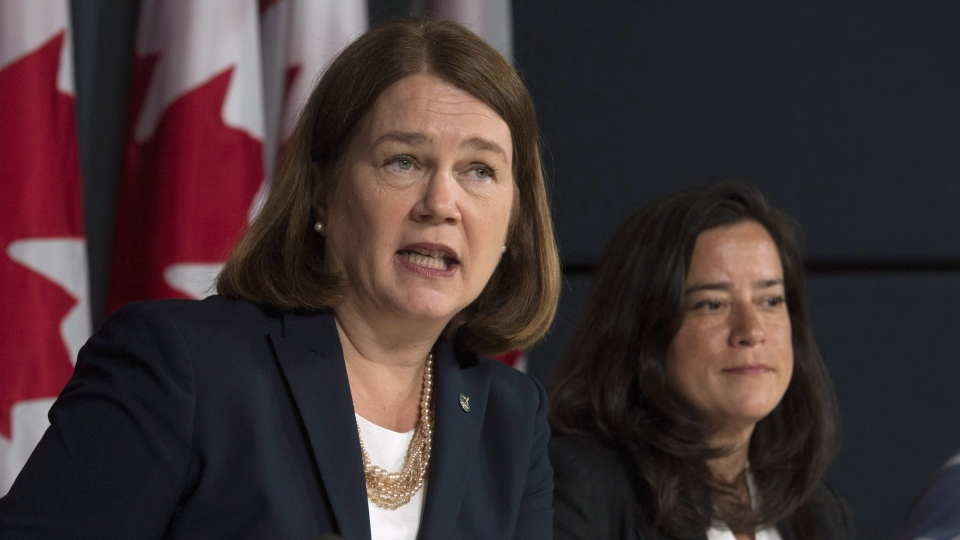 Then-ministers  Jane Philpott and Jody Wilson-Raybould during a news conference in Ottawa, Thursday June 30, 2016 THE CANADIAN PRESS/Adrian Wyld