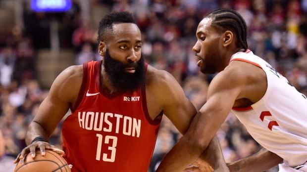ea52813aaa87 Houston Rockets guard James Harden (13) controls the ball as Toronto  Raptors forward Kawhi Leonard (2) defends during second half NBA basketball  action in ...