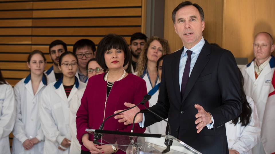 Bill Morneau, Minister of Finance, right, speaks as Ginette Petitpas Taylor, federal Minister of Health, listens during a press conference on the national pharmacare program at the Li Ka Shing Knowledge Institute in Toronto on Wednesday, March 6, 2019. THE CANADIAN PRESS/ Tijana Martin