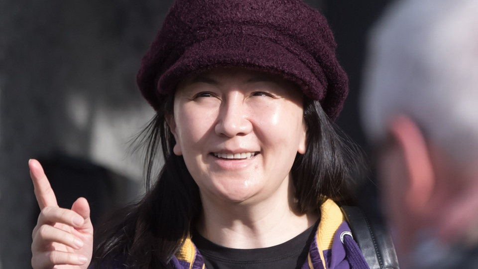 Huawei chief financial officer Meng Wanzhou, who is out on bail and remains under partial house arrest after she was detained Dec. 1 at the behest of American authorities, leaves her home to attend a court appearance in Vancouver, on Wednesday, March 6, 2019. THE CANADIAN PRESS/Darryl Dyck