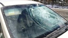 Flying ice shatters motorist's windshield