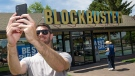 File - In this July 13, 2018 file photo, Scott Thornton takes a selfie in front of the Bend, Ore., Blockbuster. (Ryan Brennecke /The Bulletin via AP, File)