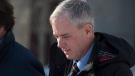 Dennis Oland heads from the Law Courts after the start of his testimony in Saint John, N.B., on Wednesday, March 6, 2019.  (THE CANADIAN PRESS/Andrew Vaughan)