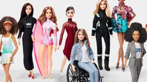 The Tessa Virtue Barbie, centre, is seen among other toys in the brand's 60th anniversary Role Models collection. (Mattel / HO)