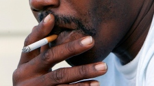 In this Oct. 4, 2005 file photo, a man smokes a cigarette in Euharlee, Ga. (AP Photo/Ric Feld)