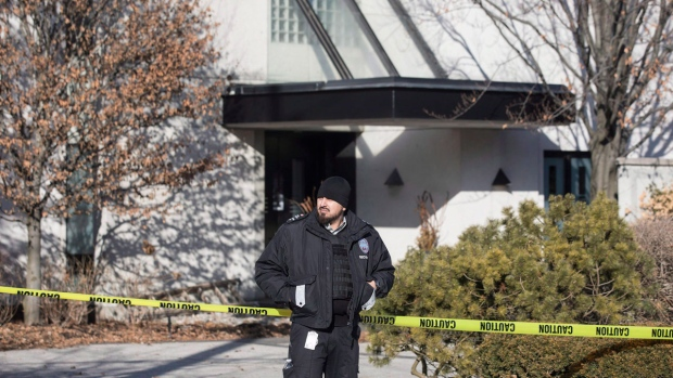 A private security guard stands outside the Toronto home of Barry and Honey Sherman on Friday, January 26, 2018. THE CANADIAN PRESS/Chris Young