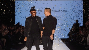 Designers Kirk Pickersgill, left, and Stephen Wong celebrate after the Greta Constantine show at Toronto Fashion Week in Toronto on Friday, March 18, 2016. (THE CANADIAN PRESS/Galit Rodan)