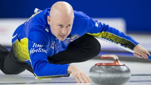 FILE - Team Alberta skip Kevin Koe makes a shot during the 16th draw against team wild-card at the Brier in Brandon, Man., Thursday, March, 7, 2019. THE CANADIAN PRESS/Jonathan Hayward
