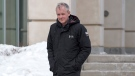 Dennis Oland heads from the Law Courts as he continue his testimony in Saint John, N.B., on Thursday, March 7, 2019. His trial in the bludgeoning death of his millionaire father, Richard Oland, is by judge alone. THE CANADIAN PRESS/Andrew Vaughan