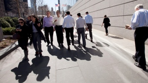 In this March 14, 2012, file photo people come and go from Goldman Sachs headquarters in New York. (AP Photo/Mark Lennihan, File)