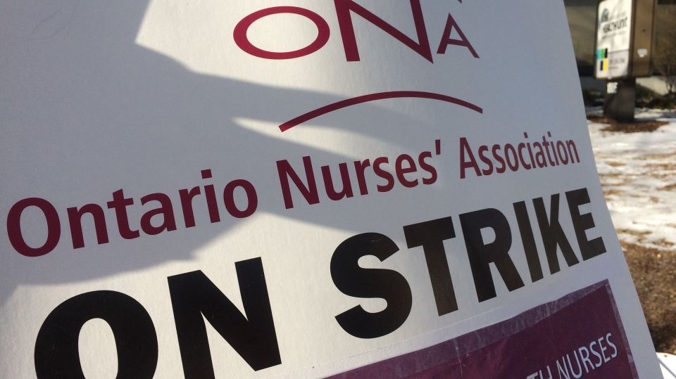 """An """"on Strike"""" sign held by a nurse at the Windsor Essex County Health Unit, who are picketing on March 8, 2019. (Michelle Maluske / CTV Windsor)"""