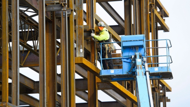 A ironworker builds a structure in Ottawa on March 5, 2018. THE CANADIAN PRESS/Sean Kilpatrick