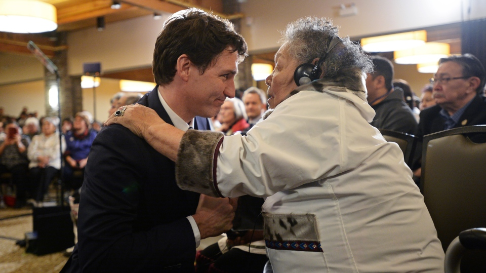 Prime Minister Justin Trudeau is greeted by an Inuit Elder prior to delivering an official apology to Inuit for the federal government's management of tuberculosis in the Arctic from the 1940s to the 1960s during an event in Iqaluit, Nunavut on Friday, March 8, 2019. THE CANADIAN PRESS/Sean Kilpatrick