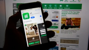 This photo shows the Absher App on a phone in Jiddah, Saudi Arabia, Thursday, March 7, 2019. (AP Photo/Amr Nabil)