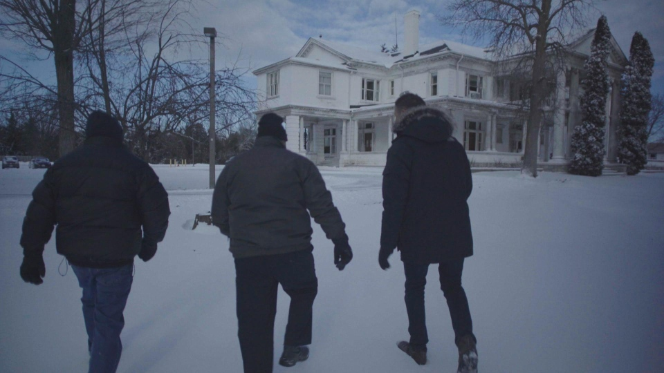 From left: Training school abuse survivors Phil Mynott and Rick Brown, and W5's Peter Akman, walk towards the former grounds of Brookside Training School in Cobourg, Ont. (W5)