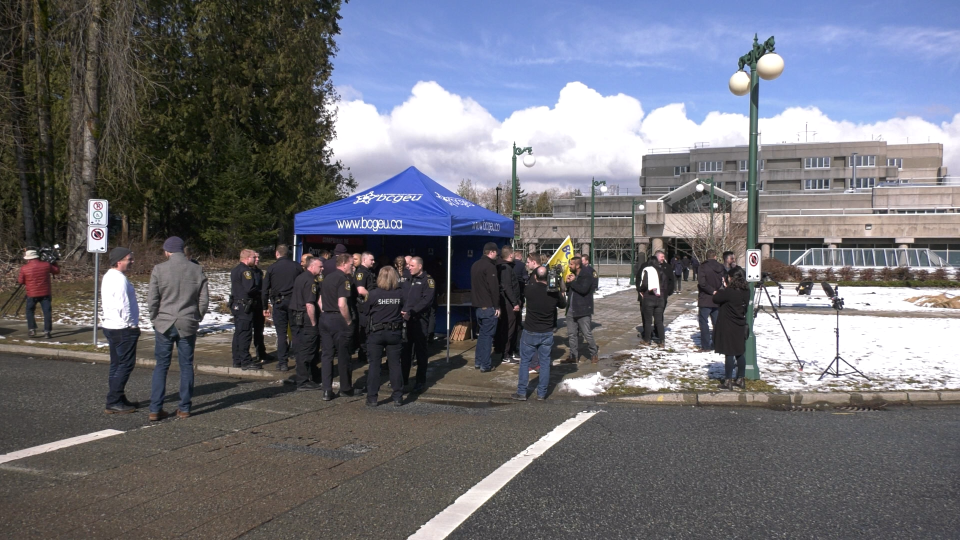 A group of correctional officers stand outside Surrey Pretrial Centre on Friday, March 8, 2019. (Steve Saunders / CTV Vancouver)