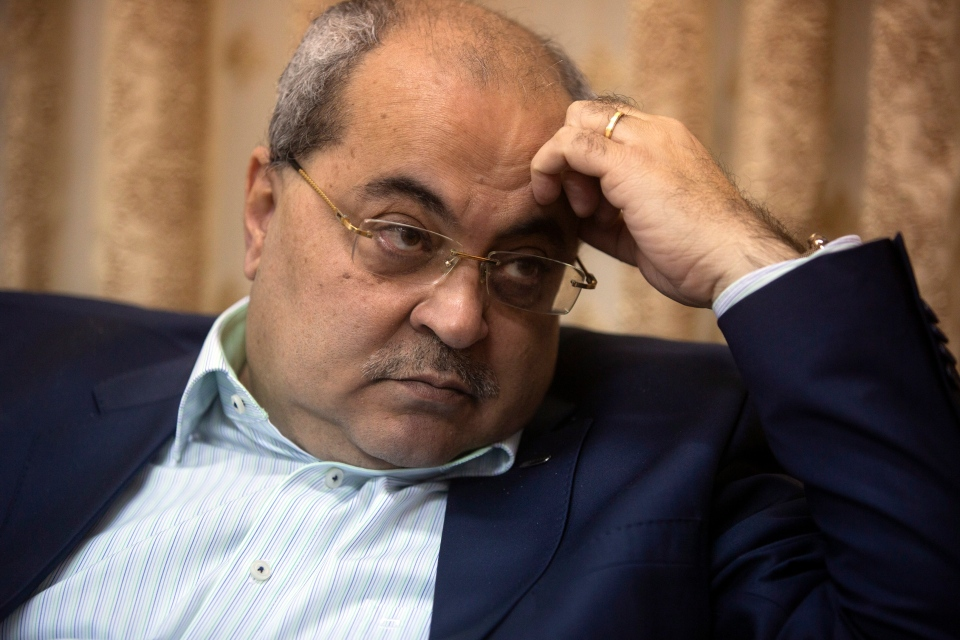 In this Wednesday, March 6, 2019 photo, Arab lawmaker Ahmad Tibi speaks during an interview with the Associated Press at his home in Jerusalem. (AP Photo/Sebastian Scheiner)
