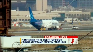 In this image taken from video provided by News12 New Jersey, Air Transat Flight 942 is towed along the runway at Newark Liberty International Airport, Saturday, March 9, 2019 in Newark NJ. (News12 New Jersey via AP)