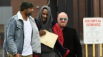Singer R. Kelly center, walks with his attorney Steve Greenberg right, and an unidentified man left, who gave him a ride after being released from Cook County Jail, March 9, 2019, in Chicago. (AP Photo/Paul Beaty)
