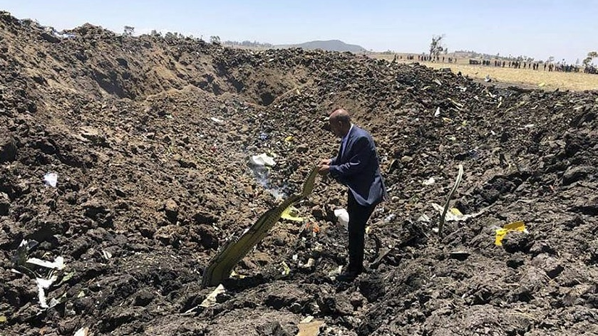 CEO of Ethiopian Airlines, Tewolde Gebremariam, looks at the wreckage of the plane that crashed shortly after takeoff from Addis Ababa, Ethiopia, Sunday March 10, 2019. (Facebook via AP)