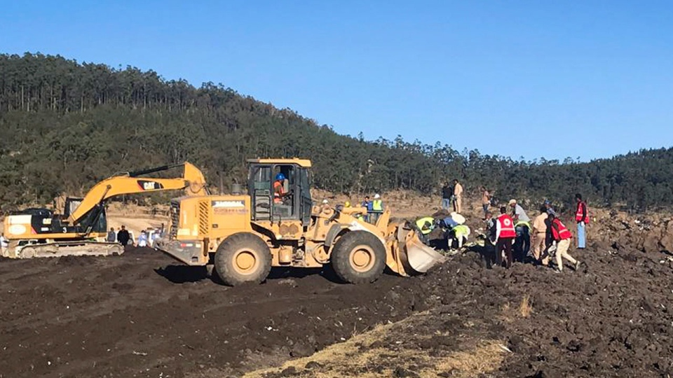Rescuers use a mechanical digger at the scene of an Ethiopian Airlines flight that crashed shortly after takeoff at the scene at Hejere near Bishoftu, or Debre Zeit, some 50 kilometers (31 miles) south of Addis Ababa, in Ethiopia Sunday, March 10, 2019. The Ethiopian Airlines flight crashed shortly after takeoff from Ethiopia's capital on Sunday morning, killing all 157 on board, authorities said, as grieving families rushed to airports in Addis Ababa and the destination, Nairobi. (AP Photo/Yidnek Kirubel)