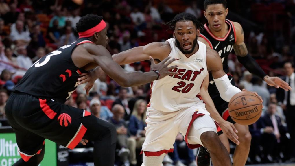 0928c828bc0 Raptors beat Heat 125-104. toronto raptors. Miami Heat forward ...