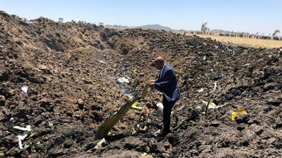 In this photo taken from the Ethiopian Airlines Facebook page, the CEO of Ethiopian Airlines, Tewolde Gebremariam, looks at the wreckage of the plane that crashed shortly after takeoff from Addis Ababa, Ethiopia, Sunday March 10, 2019.(Facebook via AP)