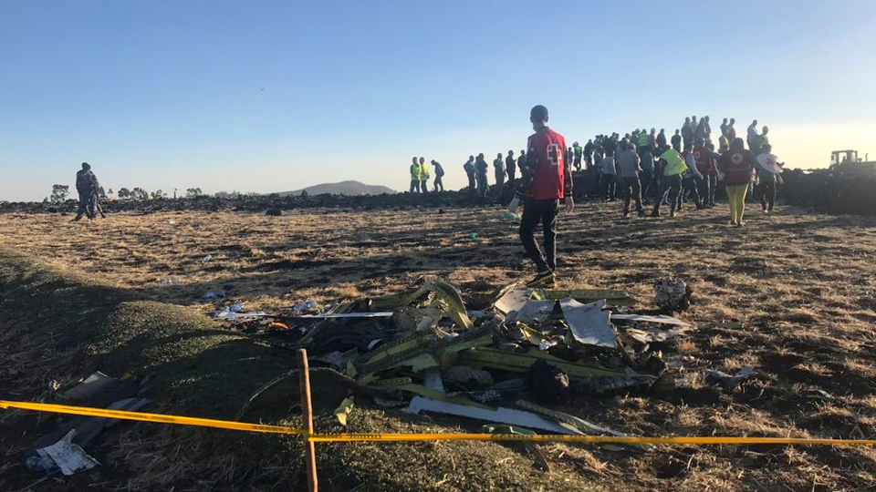 Rescuers search at the scene of an Ethiopian Airlines flight that crashed shortly after takeoff at the scene at Hejere near Bishoftu, or Debre Zeit, some 50 kilometers (31 miles) south of Addis Ababa, in Ethiopia Sunday, March 10, 2019.  (AP Photo/Yidnek Kirubel)