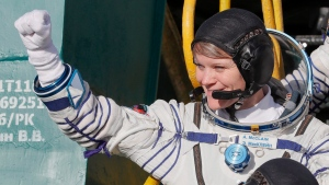 U.S. astronaut Anne McClain, crew member of the mission to the International Space Station, ISS, waves as she boards the Soyuz-FG rocket at the Russian leased Baikonur cosmodrome, Kazakhstan, Monday, Dec. 3, 2018. (AP Photo/Shamil Zhumatov, Pool)