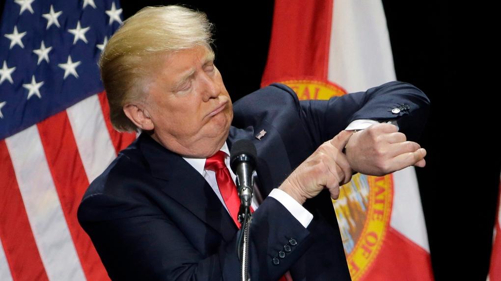 Trump checks his watch