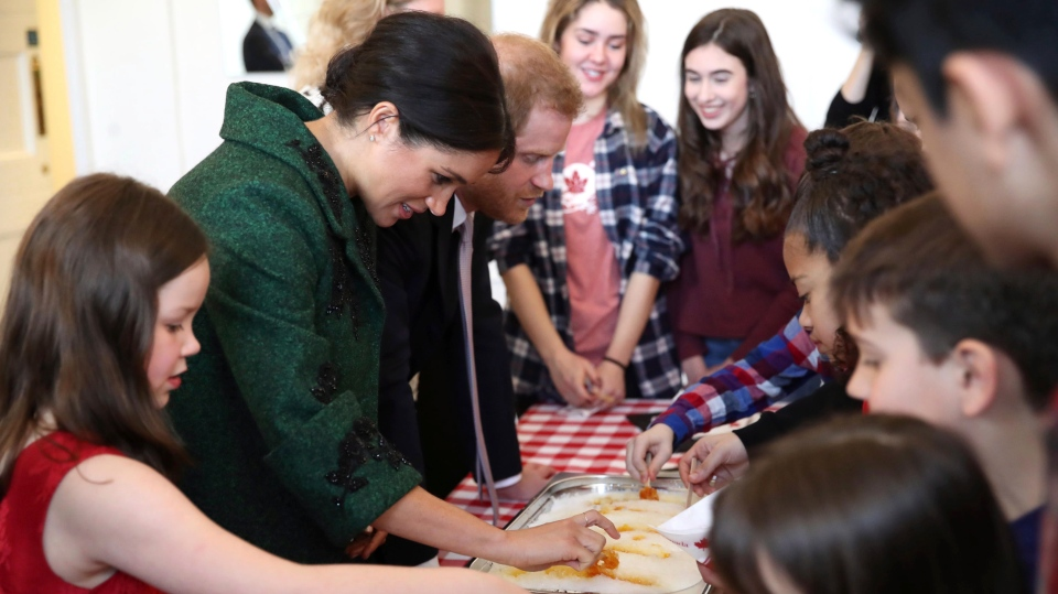 Prince Harry and Meghan, Duchess of Sussex attend the Commonwealth Day Youth Event at Canada House in London, Monday, March 11, 2019. (Chris Jackson/Pool Photo via AP)