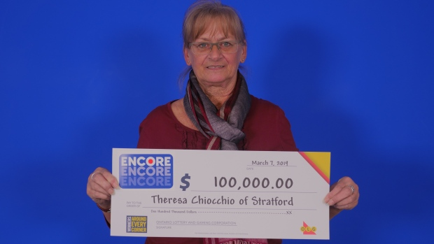 A woman with a $100,000 cheque