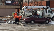 A damaged sedan in downtown Lethbridge on Monday after a commercial vehicle caused several power poles to topple