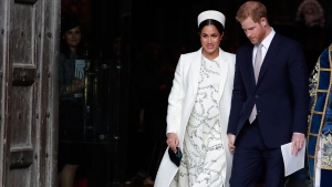 Meghan, the Duchess of Sussex and Prince Harry leave after attending the Commonwealth Service at Westminster Abbey on Commonwealth Day in London, Monday, March 11, 2019. (AP Photo/Frank Augstein)